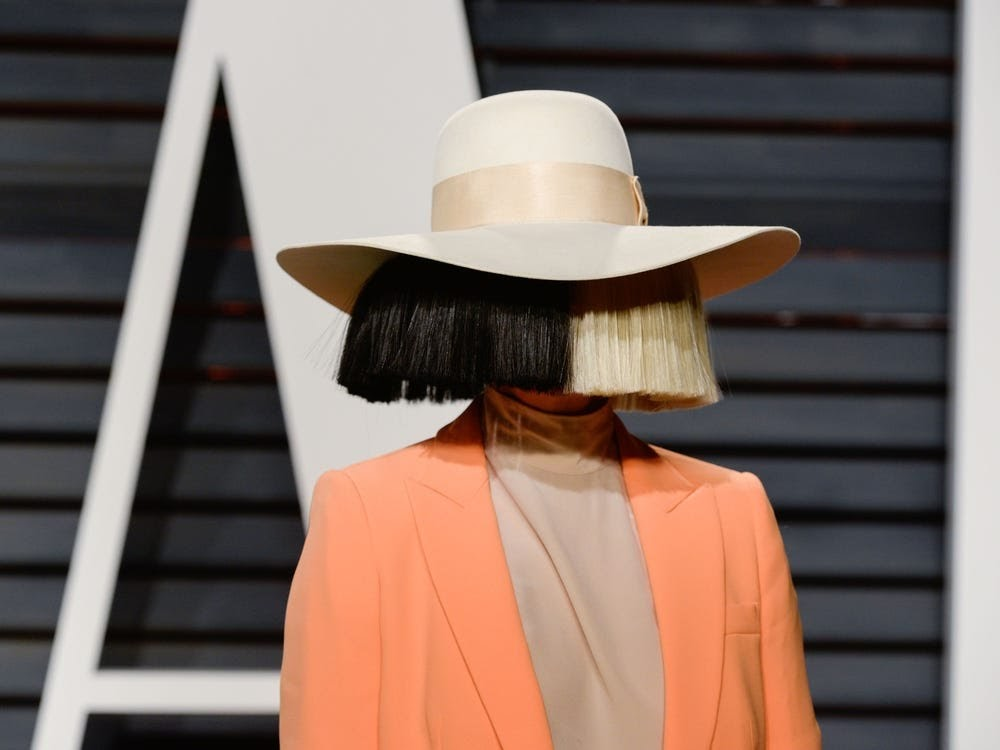 why does sia hide her face
